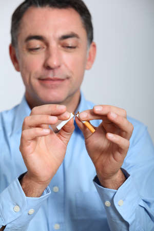 man smoking: Closeup of man trying to quit smoking Stock Photo