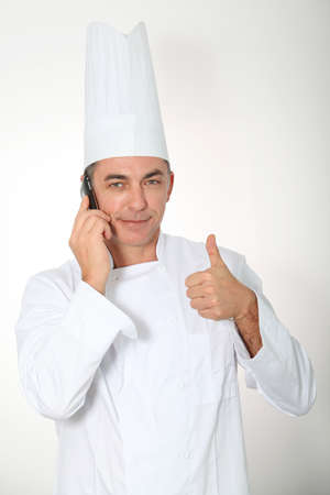 Closeup of chef talking on the phone