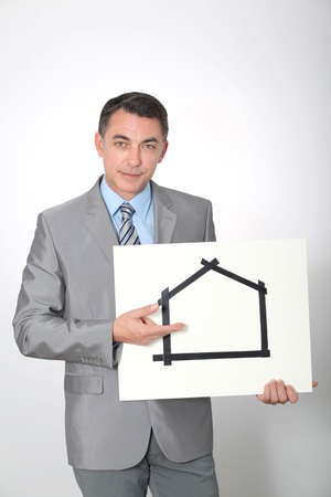 Businessman showing for sale sign photo