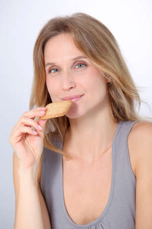 Closeup of woman eating cookie Stock Photo - 8360904