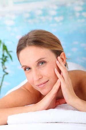 Closeup of beautiful blond woman on a massage bed photo