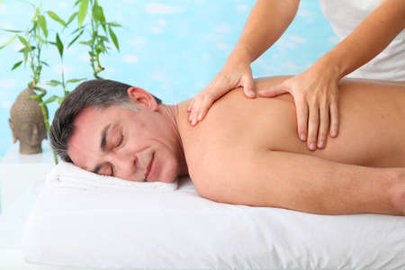 men 45 years: Man having a massage in a spa center