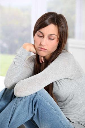sad old woman: Closeup of depressed young woman Stock Photo