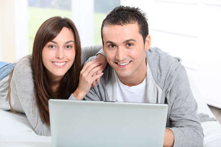Young couple surfing on internet Stock Photo - 8360236