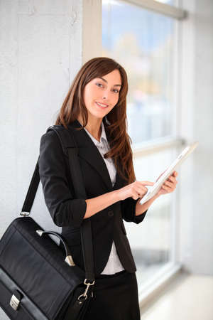 electronic pad: Businesswoman standing in hall with electronic pad
