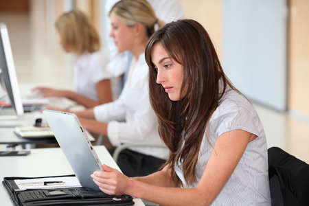 electronic pad: Businesswoman working in the office on electronic pad Stock Photo