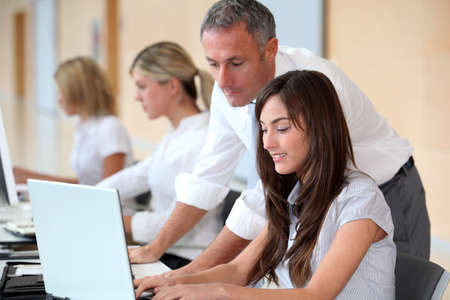 Business team working in the office on laptop computer Stock Photo - 8362841