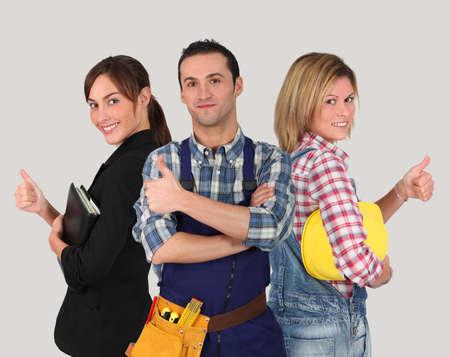artisanale: Groep van jonge werknemers op witte achtergrond Stockfoto