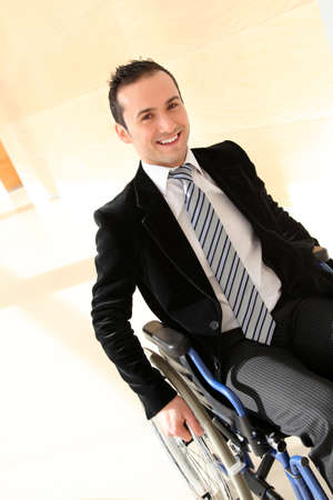 Businessman in wheelchair going to attend congress meeting photo