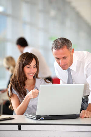 Manager and secretary working in the office Stock Photo - 8350462