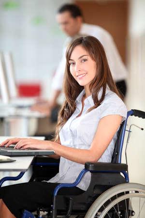 saleswomen: Businesswoman in wheelchair working in the office