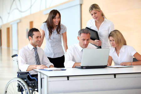 handicap: Group of office workers in a business meeting