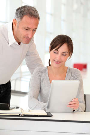 electronic pad: Business people working in ofice with electronic pad
