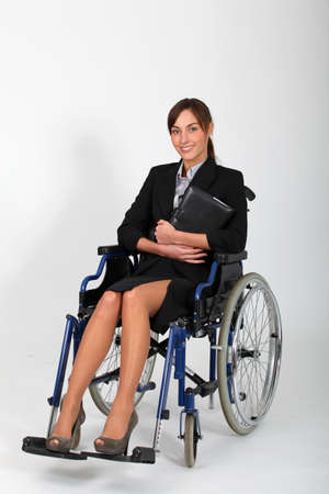 Young businesswoman in wheelchair photo