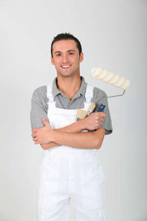house painter: Portrait of happy young house painter Stock Photo