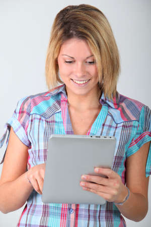 electronic pad: Young woman with electronic pad Stock Photo