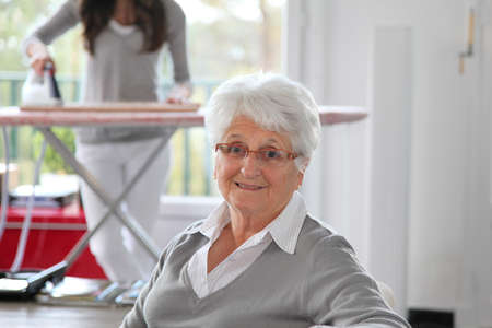 homecare: Closeup of elderly woman with home help Stock Photo