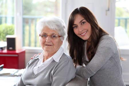 carer: Closeup of elderly woman with young woman