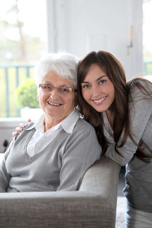 Closeup of elderly woman with young woman photo
