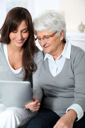 Elderly woman with grandaughter with laptop computer Stock Photo - 8375235