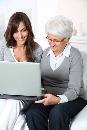 Elderly woman with grandaughter with laptop computer Stock Photo - 8374660