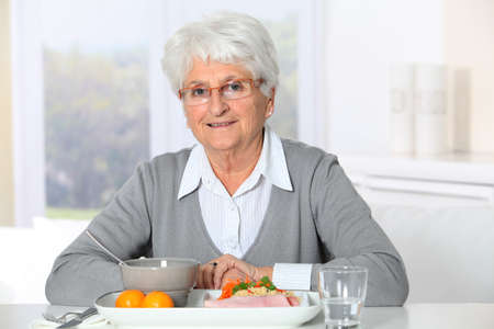 Old woman in nursing home ready to have dinner photo
