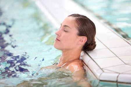 Beautiful young woman relaxing in seawater pool Stock Photo - 8374655
