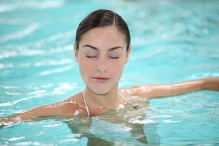 Beautiful young woman relaxing in seawater pool Stock Photo - 8375203
