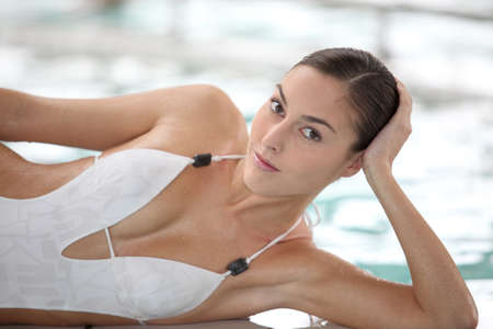 Beautiful woman in thalassotherapy spa center photo