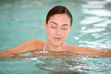 Beautiful young woman relaxing in seawater pool  Stock Photo - 8375220