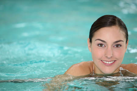 Beautiful young woman relaxing in seawater pool  photo