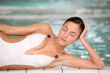 Closeup of beautiful woman in thalassotherapy and spa center photo