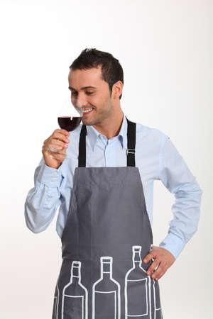 Sommelier tasting red wine photo