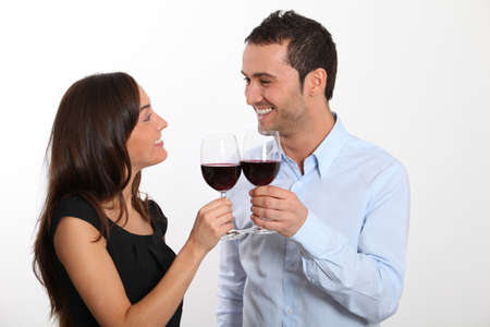 red wine glasses: Couple tasting red wine Stock Photo