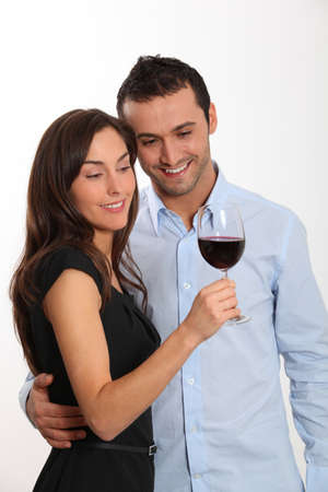 Couple tasting red wine photo