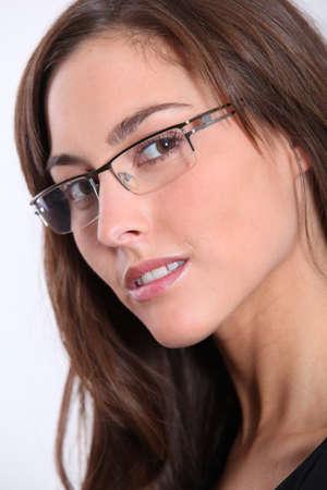 着て眼鏡美人のクローズ アップ 写真素材