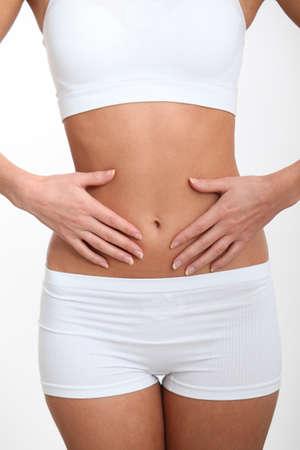cintura perfecta: Detalle de abdomen delgado perfecto
