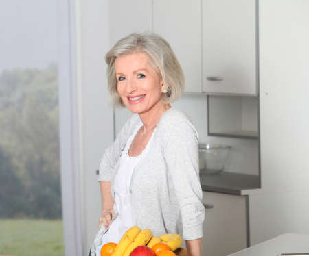 Senior woman standing in kitchen Stock Photo - 8400718
