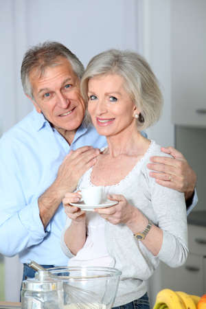 Senior couple taking coffee in kitchen Stock Photo - 8401862