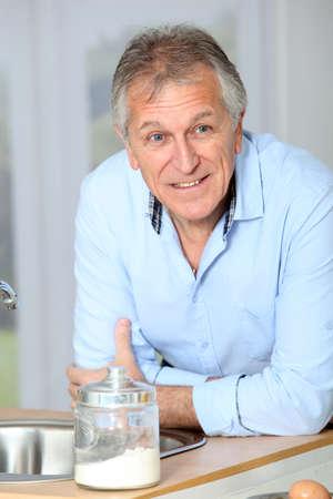 Closeup of senior man in home kitchen photo
