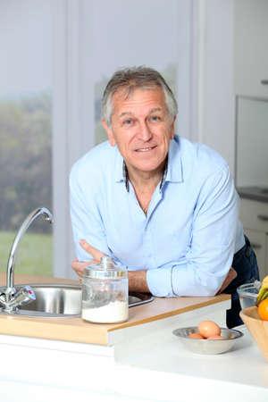 Closeup of senior man in home kitchen Stock Photo - 8400859