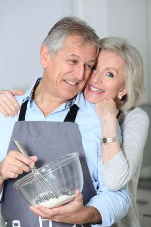 Happy senior couple baking together  photo