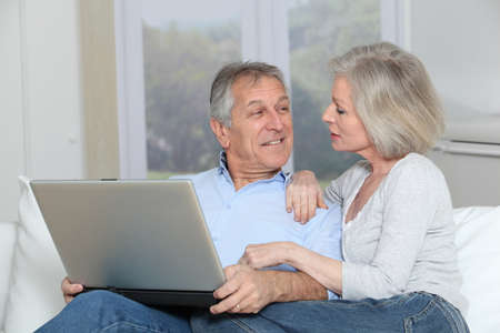 Senior couple surfing on internet photo