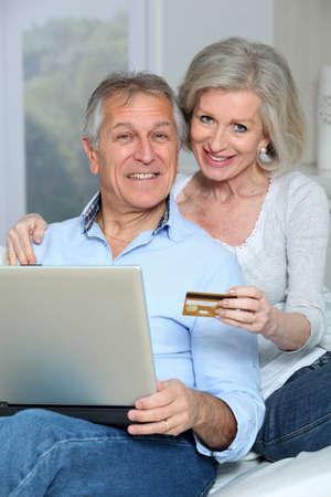 Senior couple doing online shopping photo