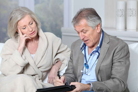 visit: Doctor writing prescription to patient