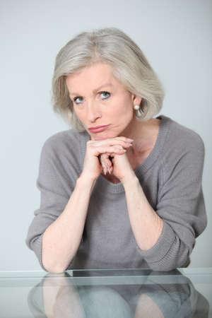 unconcerned: Senior woman with unconcerned expression