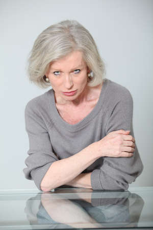 Senior woman with mad look photo
