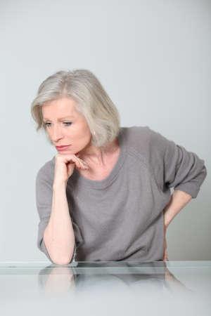 Senior woman with unhappy expression photo