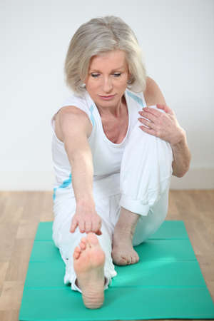 healthy seniors: Senior woman doing stretching exercises