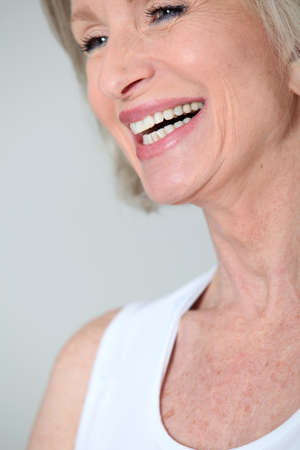 Closeup of senior woman with beautiful smile photo